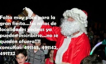27 Fiesta de Navidad con la llegada de Papa Noel en Colonia Hinojo